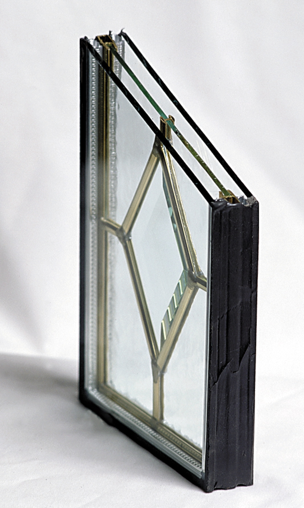 ... of an efficient triple-pane decorative glass panel. Notice how the center decorative panel is protected on both sides. - Photo credit - Madawaska Doors & Dulley Column - Color graphics